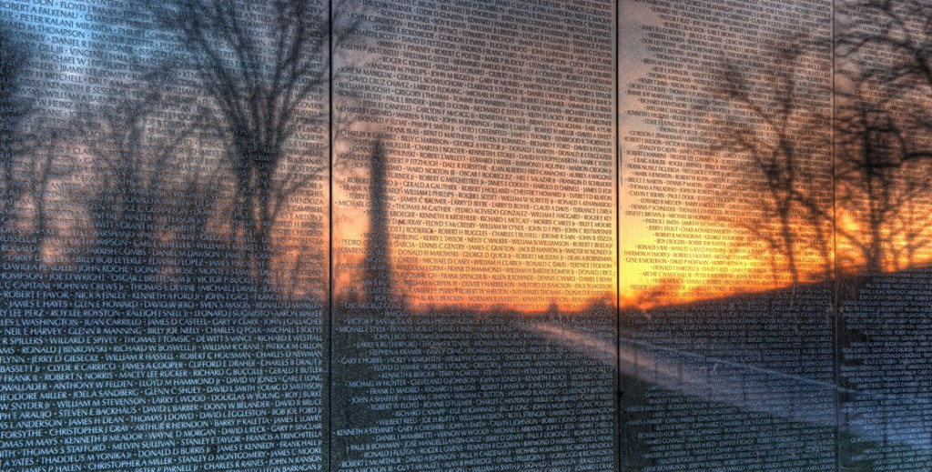 Sunrise through the reflection of the Vietnam Mem.